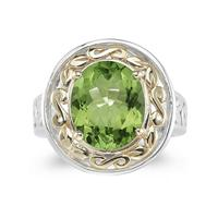 4.45ct.Oval Shape Peridot Ring in Yellow Gold and Silver