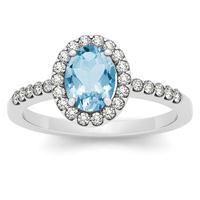 1.10 Carat Oval Blue Topaz and Diamond Halo Ring in 14K White Gold