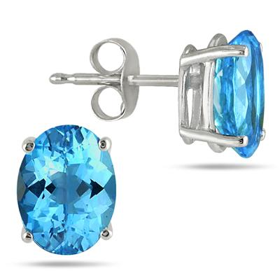 7x5MM All Natural Oval Blue Topaz Stud Earrings in .925 Sterling Silver