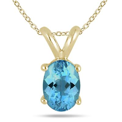 All-Natural Genuine 6x4 mm, Oval Blue Topaz pendant set in 14k Yellow gold