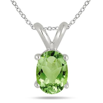 All-Natural Genuine 6x4 mm, Oval Peridot pendant set in 14k White Gold