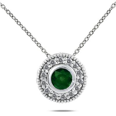 1/6 Carat TW Diamond and Emerald Pendant in 10K White Gold
