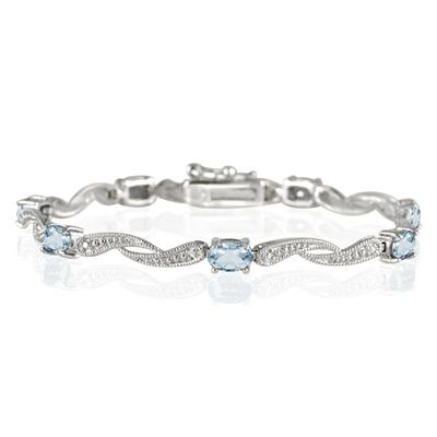 4.00 Carat Blue Topaz and Diamond Bracelet in Rhodium Plated Brass
