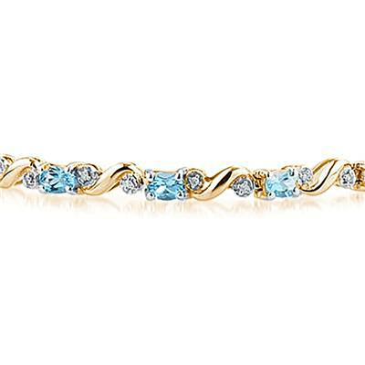 10k Yellow  Gold Diamond and Blue Topaz Bracelet