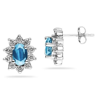 6X4mm Oval Shaped Blue Topaz and Diamond Flower Earrings in 14k White Gold