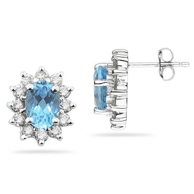 7X5mm Oval Shaped Blue Topaz and Diamond Flower Earrings in 14k White Gold