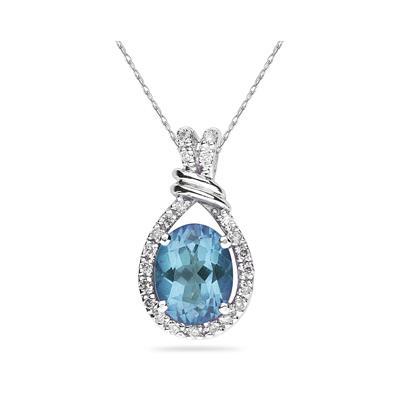 Oval Shaped Blue Topaz and Diamonds Pendant in White Gold