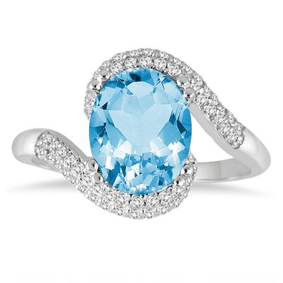 2.50 Carat Oval Shaped Blue Topaz and Diamond Curve Ring in 10K White Gold