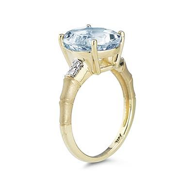 Oval Shaped   Aquamarine  and Diamond Curve Ring in 10K Yellow  Gold