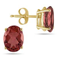 All-Natural Genuine 7x5 mm, Oval Garnet earrings set in 14k Yellow gold