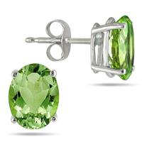 All-Natural Genuine 7x5 mm, Oval Peridot earrings set in 14k White Gold