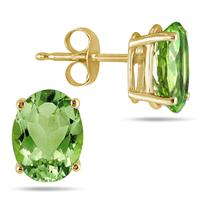 All-Natural Genuine 7x5 mm, Oval Peridot earrings set in 14k Yellow gold