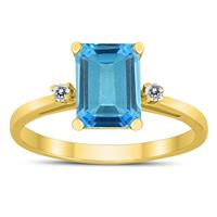 Emerald Cut 8X6MM Blue Topaz and Diamond Three Stone Ring in 10K Yellow Gold
