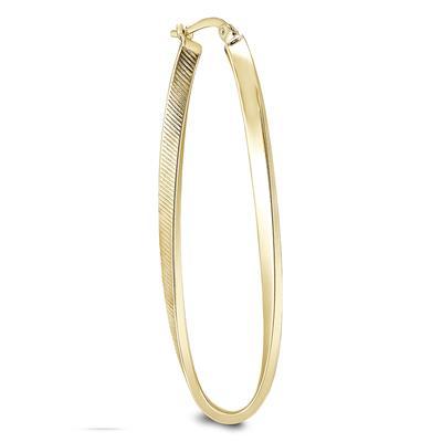 Oval Hoop Twist Earrings in 14K Yellow Gold