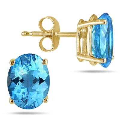 All-Natural Genuine 8x6 mm, Oval Blue Topaz earrings set in 14k Yellow gold