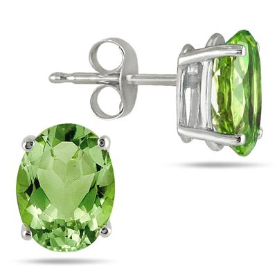 All-Natural Genuine 8x6 mm, Oval Peridot earrings set in 14k White Gold