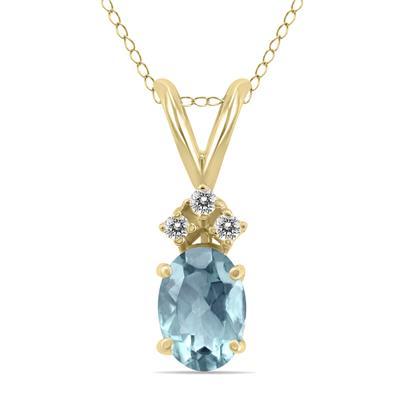 14K Yellow Gold 6x4MM Oval Aquamarine and Diamond Pendant