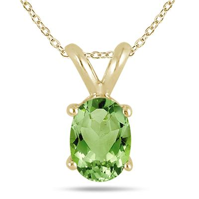 All-Natural Genuine 7x5 mm, Oval Peridot pendant set in 14k Yellow gold