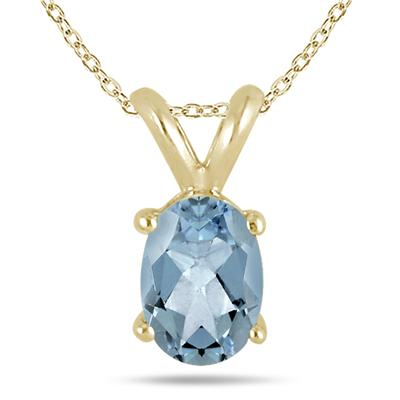 All-Natural Genuine 8x6 mm, Oval Aquamarine pendant set in 14k Yellow gold