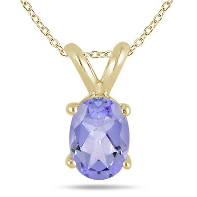 All-Natural Genuine 8x6 mm, Oval Tanzanite pendant set in 14k Yellow gold