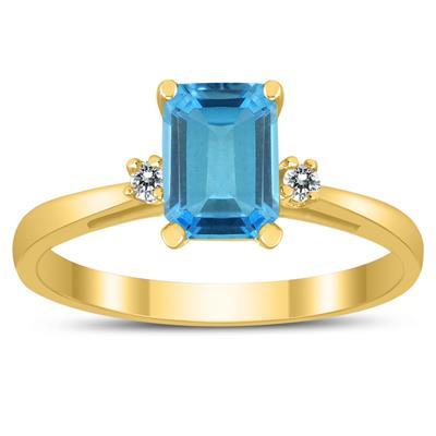 Emerald Cut 7X5MM Blue Topaz and Diamond Three Stone Ring in 10K Yellow Gold