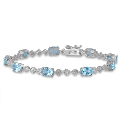 10 Carat Oval Blue Topaz and Diamond Bracelet in Rhodium Plated Brass