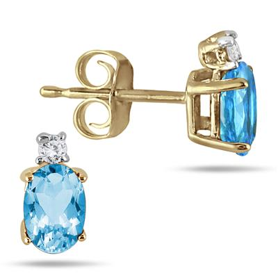 Oval Blue Topaz Drop and Diamond Earrings in 14K Yellow Gold