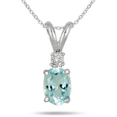 7x5mm Oval March Aquamarine Birthstone and Diamond Pendant in .925 Sterling Silver