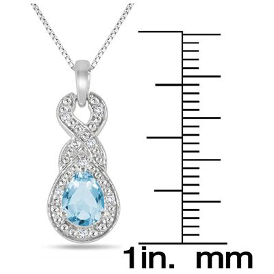 7x5 MM Pear Shape Blue Topaz and Diamond Pendant in .925 Sterling Silver