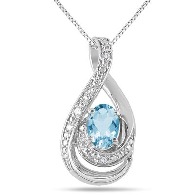 7x5 MM Blue Topaz and Diamond Pendant in .925 Sterling Silver