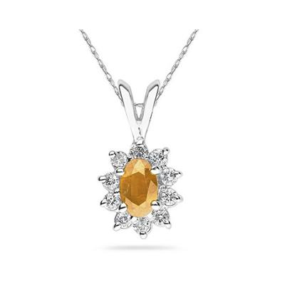 6X4mm Oval Shaped Citrine and Diamond Flower Pendant in 14k White Gold