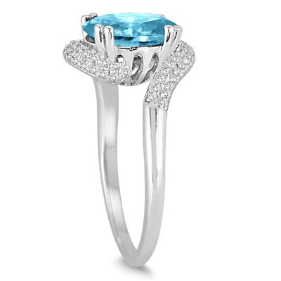 2 1/2 Carat Oval Shaped Blue Topaz and Diamond Curve Ring in 10K White Gold